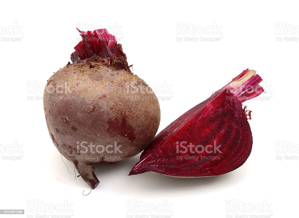 loose beet roots on white stock photo