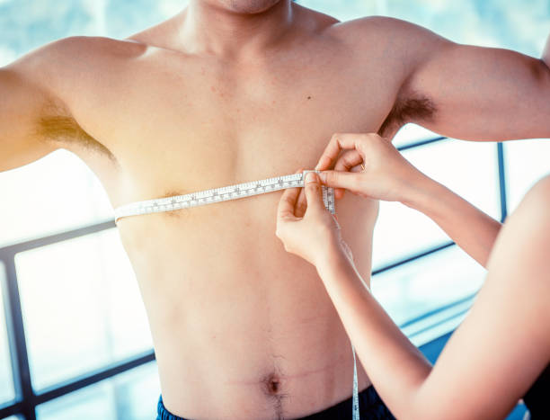 Loose Belly Fat and slender, waist measurement by using measuring tape. Mind-body improvements and firm body. Loose Belly Fat and slender, waist measurement by using measuring tape. Mind-body improvements and firm body. appropriately stock pictures, royalty-free photos & images
