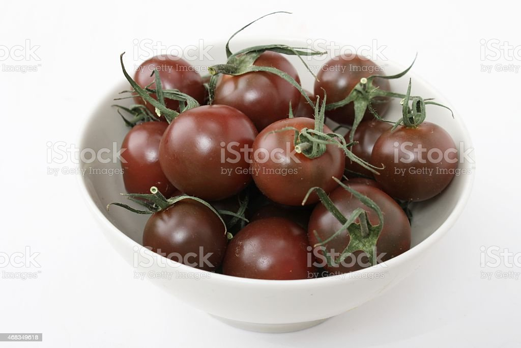 loose black vine tomatoes royalty-free stock photo