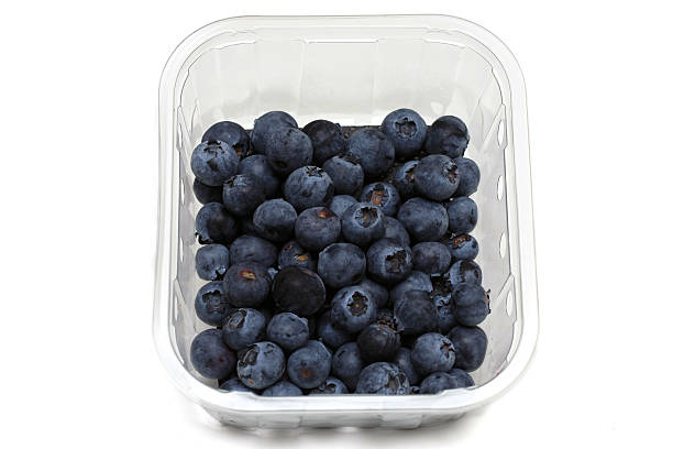 Loose Blueberries on a white background Loose Blueberries on a white background fruit carton stock pictures, royalty-free photos & images