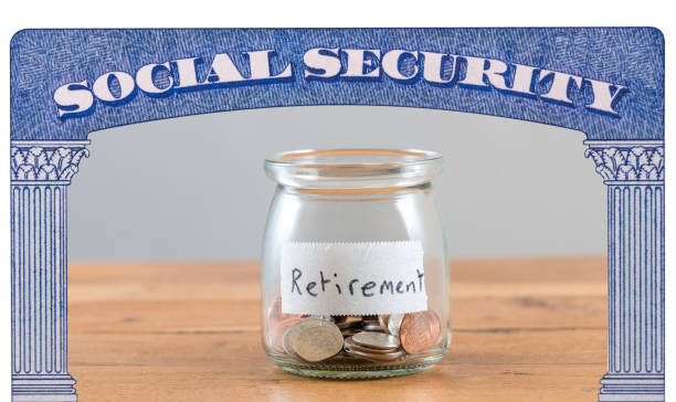 Loose change inside glass jar to represent retirement savings for Social Security stock photo