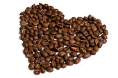 Loose coffee beans shaped as a heart against white background shot in studio