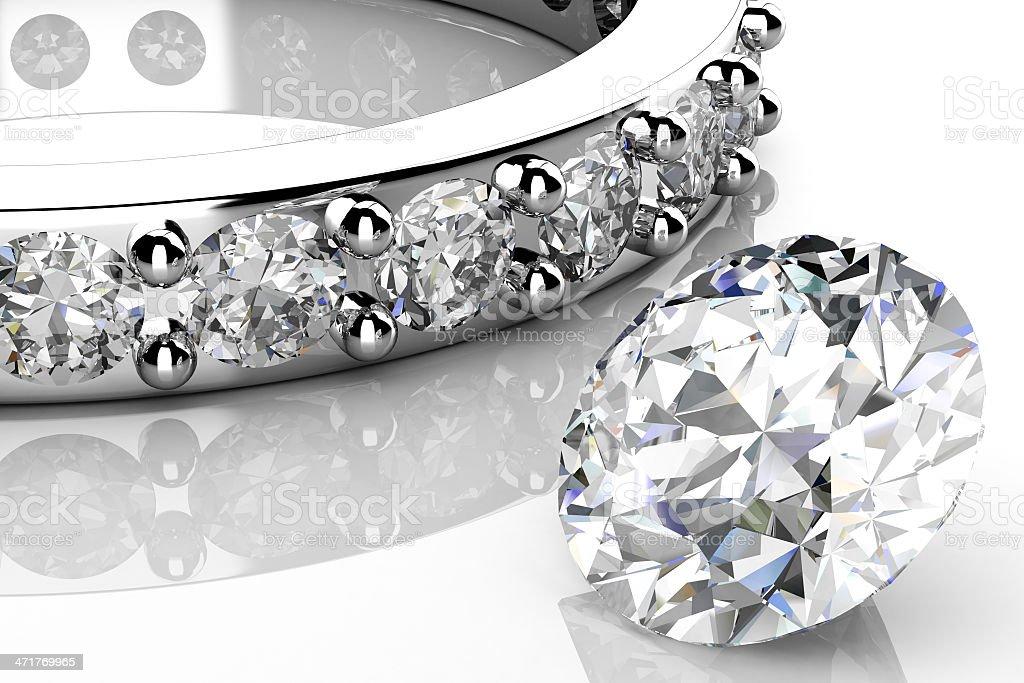 Loose diamond next to a diamond wedding band on white royalty-free stock photo