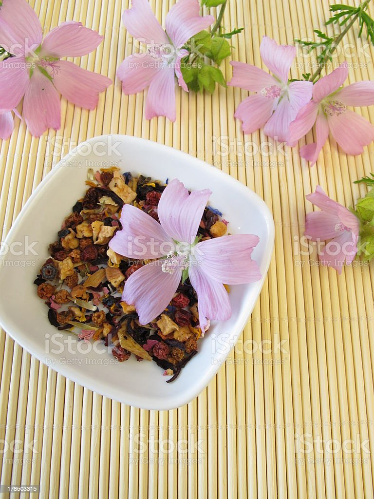 Loose fruit tea with mallow flowers royalty-free stock photo