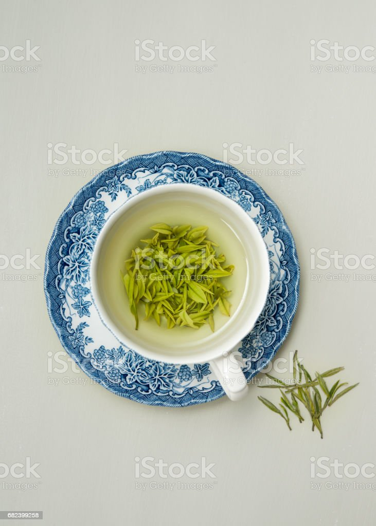 Loose leaf green tea in antique English teacup royalty-free stock photo