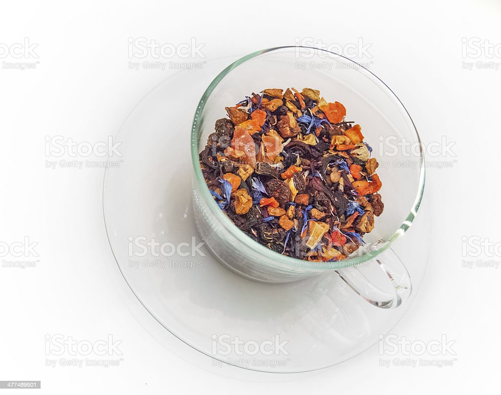 Loose leaf tea in glass tea cup and saucer stock photo