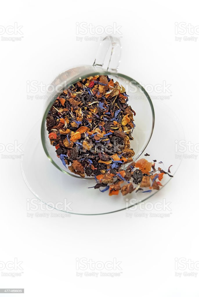 Loose leaf tea in glass tea cup and saucer royalty-free stock photo