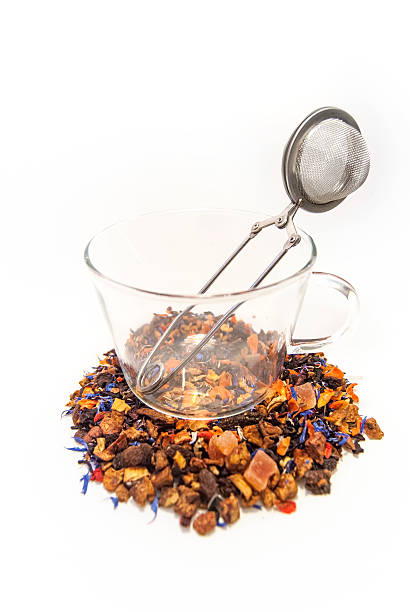 Loose leaf tea in glass tea cup with infuser stock photo