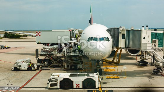istock loose luggage being loaded into narrow body aircraft 948121022