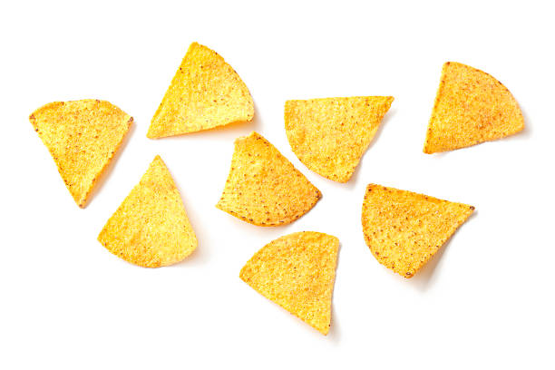 Loose tortilla chips on a white background stock photo
