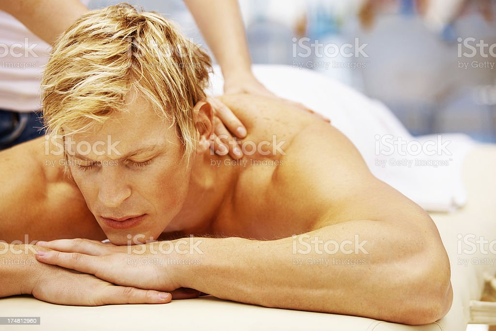 Loosening up those muscles after a taxing workout royalty-free stock photo