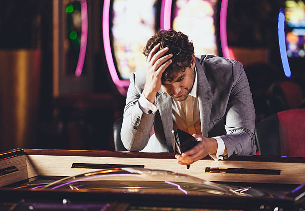 Loosing at the Casino Man loosing at the Casino game of chance stock pictures, royalty-free photos & images