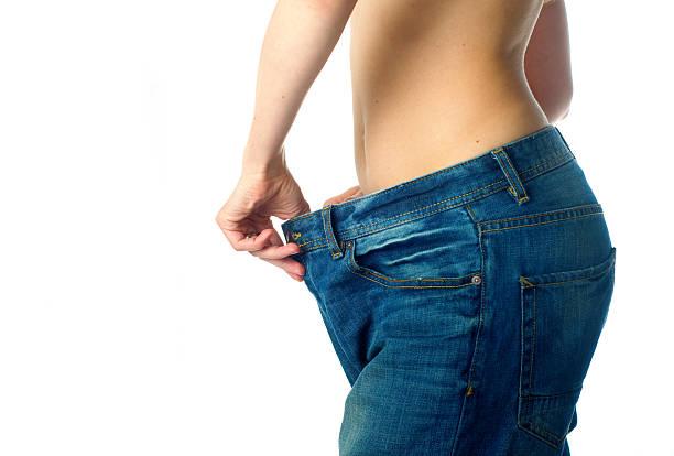 gewicht verlieren - damen sporthose übergröße stock-fotos und bilder