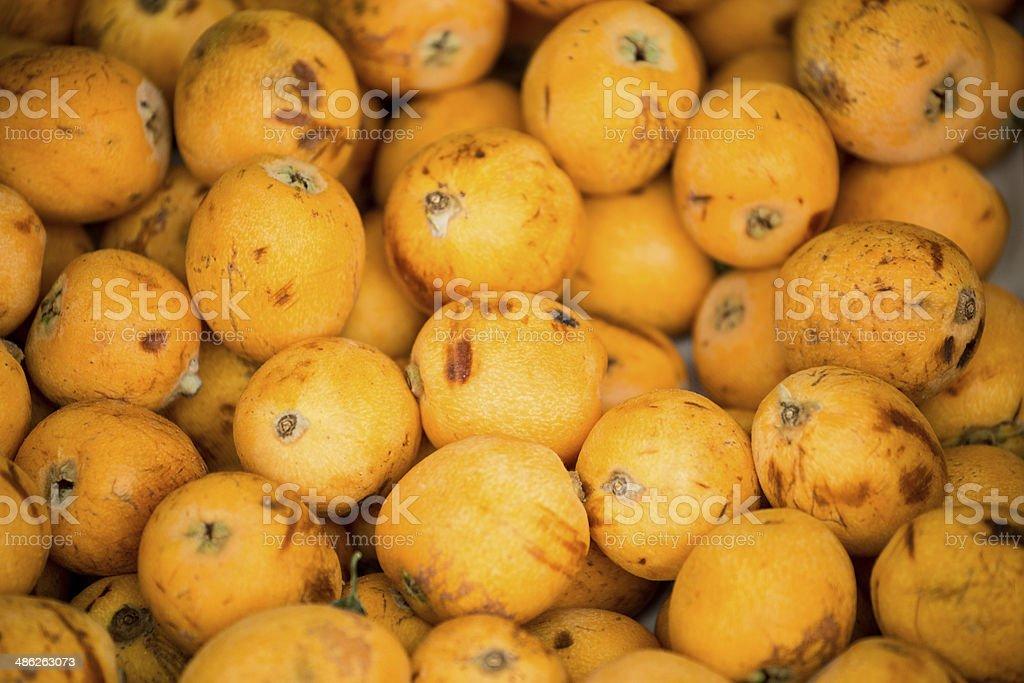 Loquat (Eriobotrya japonica) in street market royalty-free stock photo