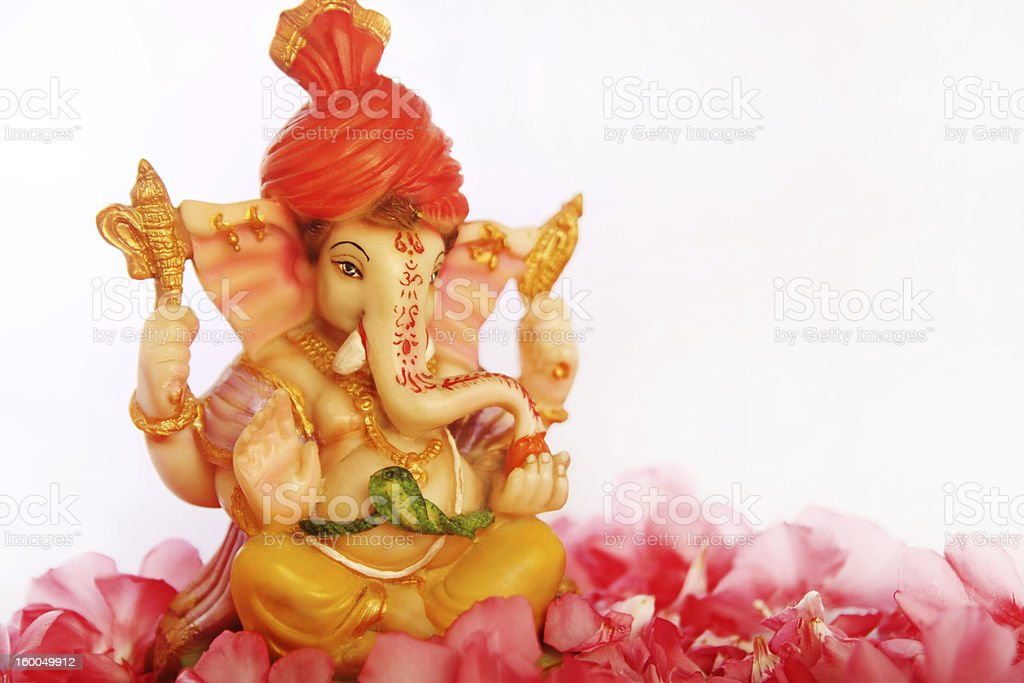 Lord Ganesha on red flower petals on a white background stock photo