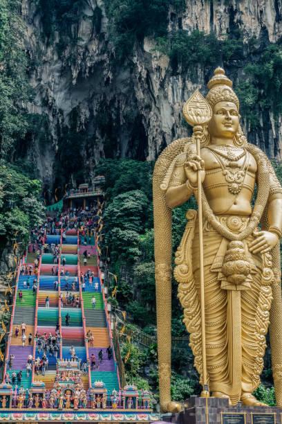 Lord Murugan statue in Batu caves. Hindu temple Famous hindu temple in Batu caves. Murugan statue batu caves stock pictures, royalty-free photos & images