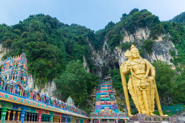Lord Murugan statue in Batu caves. Hindu temple Lord Murugan statue in Batu caves. Hindu temple batu caves stock pictures, royalty-free photos & images