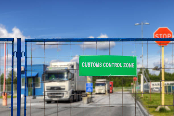 Lorries pass through checkpoint of logistics complex with customs services. Trucks pass through the checkpoint of the customs logistics terminal. customs stock pictures, royalty-free photos & images