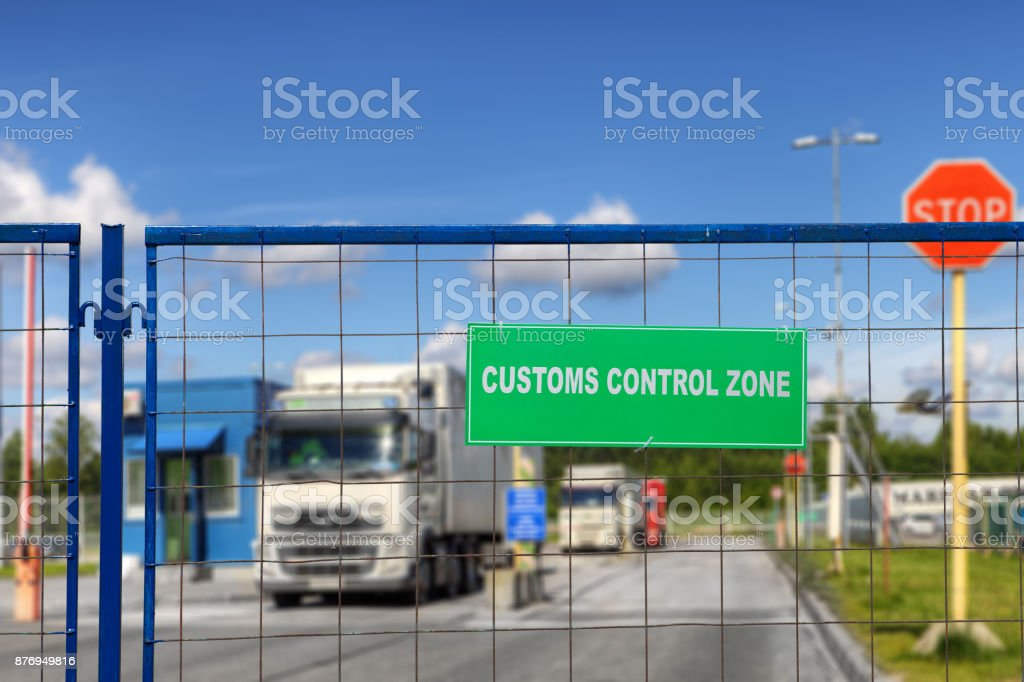 Lorries pass through checkpoint of logistics complex with customs services. stock photo