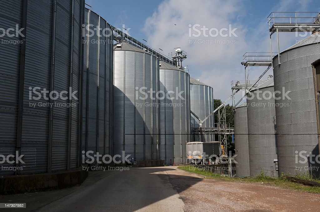 Lorry loading grain from industrial silos stock photo