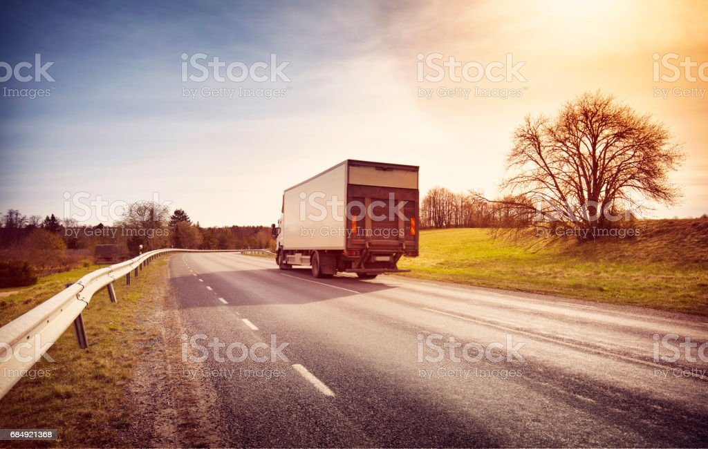 lorry moving on sunny evening Lizenzfreies stock-foto