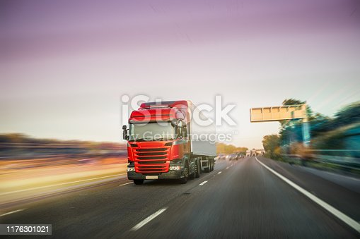 506292564 istock photo Lorry on motorway in motion 1176301021