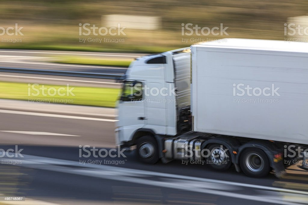 lorry on motorway with motion blur stock photo