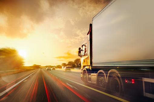 Lorry Traffic Transport on motorway in motion