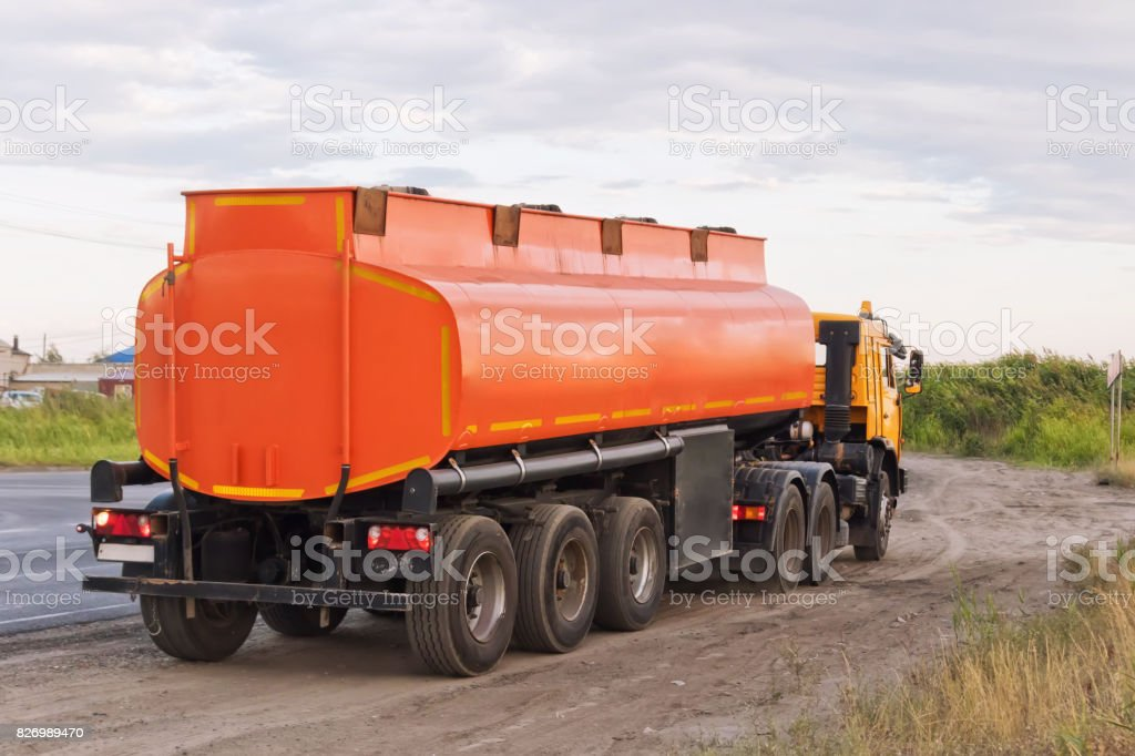 Lorry with orange tanker on parked on the roadside stock photo