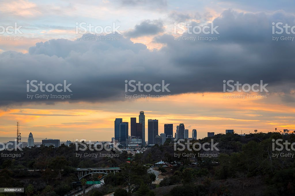 Los Aneles Skyline Under Clouds at Sunset stock photo