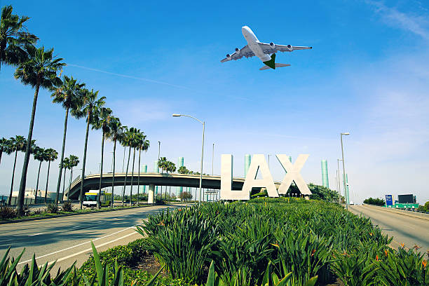 Los Angeles Airport LAX Los Angeles Airport sign full highway with airplane flying overhead. elevated road stock pictures, royalty-free photos & images