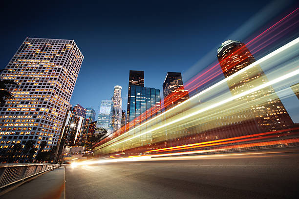 Los Angeles at night Los Angeles at night. Long exposure shot of blurred bus speeding through night street. long exposure stock pictures, royalty-free photos & images
