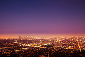 View over Los Angeles at nightfall, downtown on the left.