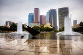 Los Angeles, United States - January 11, 2015: The Los Angeles city center with reflecting pool in the foreground