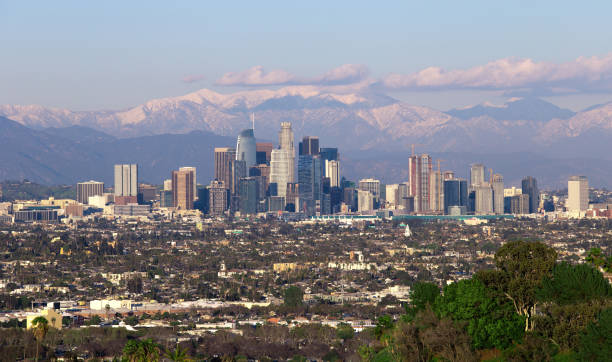 Los Angeles City Scape With Snowy Mountains stock photo