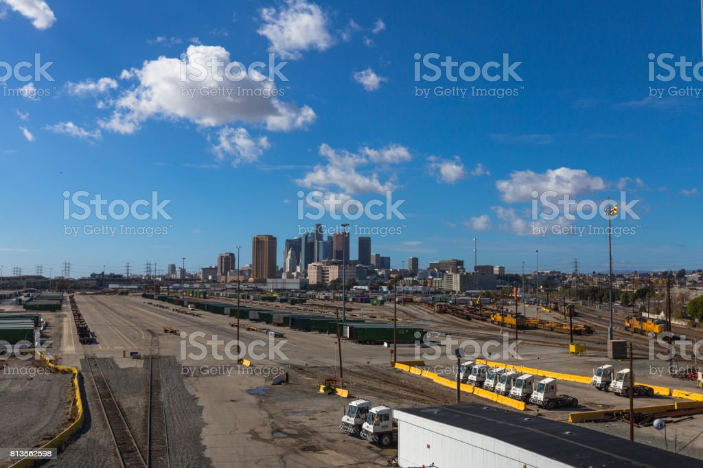 Los Angeles City skyline with truck and train terminals platforms stock photo