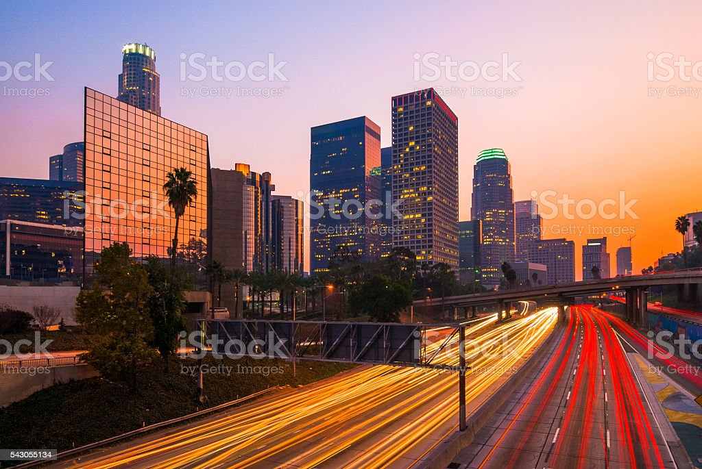 Los Angeles Downtown and Freeway at Dusk, Orange Purple Sky stock photo