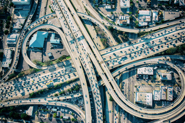 Los Angeles Freeway Interchange at Rush Hour The connecting ramps of Interstate 10 and 101 in downtown Los Angeles, California during rush hour elevated road stock pictures, royalty-free photos & images