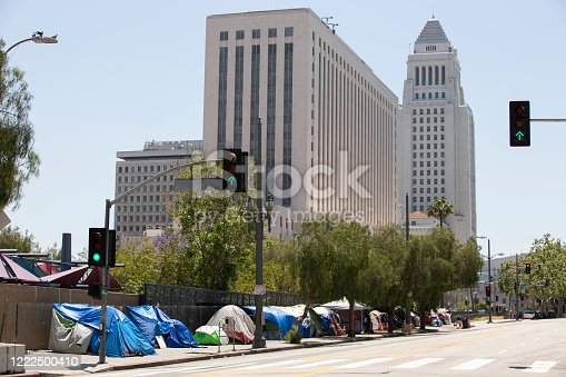 A massive tent encampment of homeless individuals on a Downtown Los Angeles sidewalk.