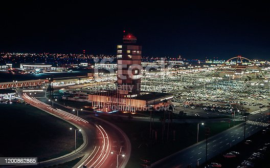 Los Angeles International Airport (LAX) at night with control tower in foreground and Theme Building in back. Los Angeles, California, USA. June 1980. Scanned film.