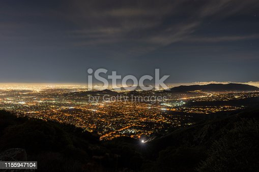 Night view of Pasadena, Glendale and downtown Los Angeles from peak in the San Gabriel Mountains.
