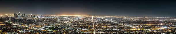 los angeles panorama at night - urban sprawl stock photos and pictures