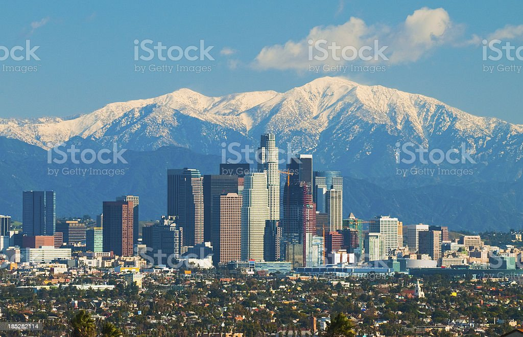 Los Angeles skyline and San Gabriel Mountains stock photo