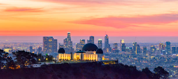 Los Angeles Skyline at Dawn Panorama and Griffith Park Observatory in the Foreground Los Angeles skyline at dawn with Griffith Park Observatory in the foreground hollywood california stock pictures, royalty-free photos & images