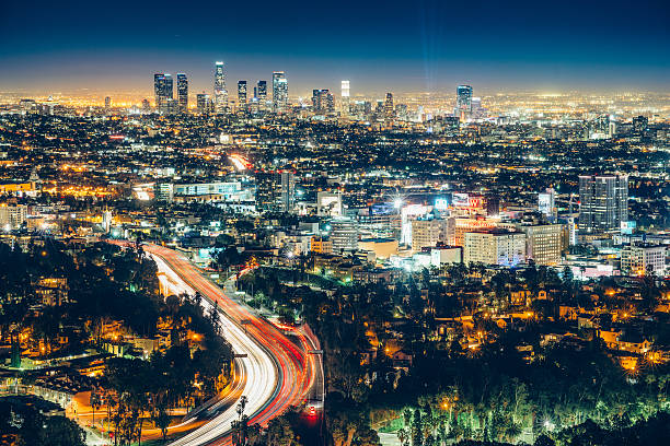 Los Angeles Skyline at Night Los Angeles Skyline at Night with cars rushing on highway 101direction downtown. hollywood boulevard stock pictures, royalty-free photos & images