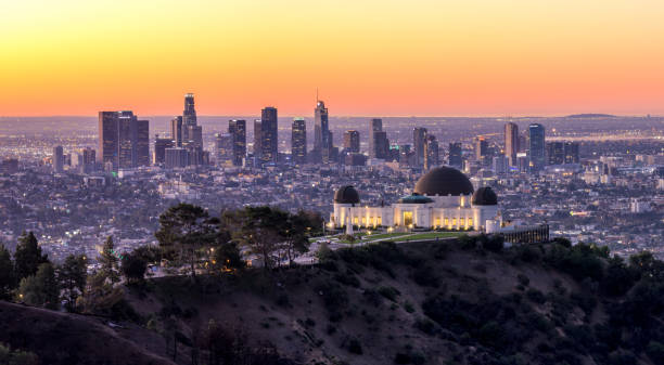 Los Angeles Skyline at Sunrise Panorama and Griffith Park Observatory in the Foreground. California. USA Los Angeles Downtown Skyline at sunrise from Griffith Park with the Observatory in the Foreground. California. United States of America hollywood california stock pictures, royalty-free photos & images