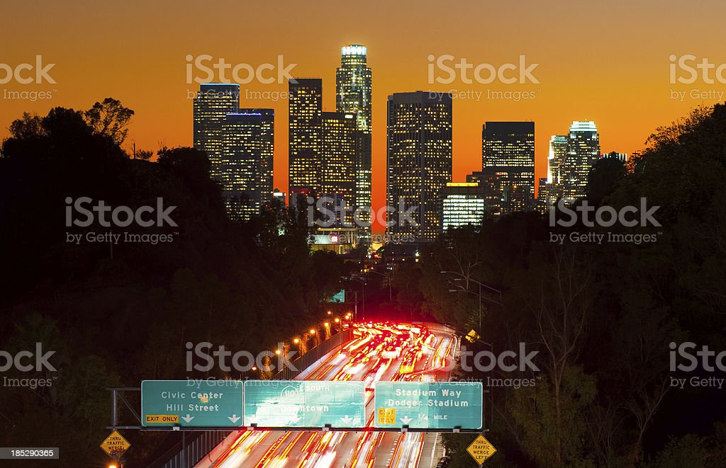 Los Angeles skyline at sunset and freeway royalty-free stock photo