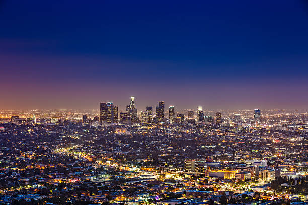 los angeles skyline by night, california, usa - international landmark stock photos and pictures