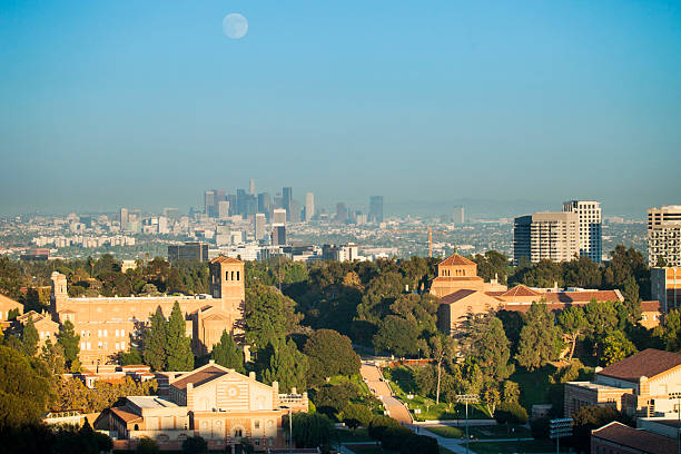 Los Angeles Skyline Image of the Los Angeles Skyline and UCLA campus with a full moon rising in the sky. westwood neighborhood los angeles stock pictures, royalty-free photos & images