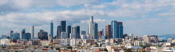 Los Angeles Skyline Los Angeles skyline with blue sky and clouds. The shot is taken from the south part od downtown. 2017 stock pictures, royalty-free photos & images